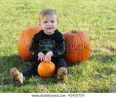 Young boy with pumpkins - stock photo