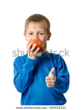 Young boy with red apple isolated on white - stock photo