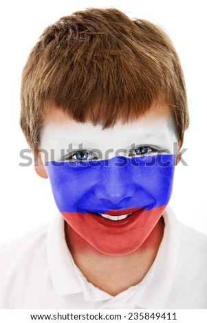 Young boy with russian flag painted on his face