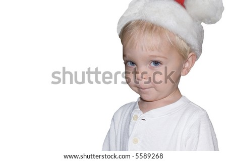 Young boy with Santa hat and a cute smile - stock photo