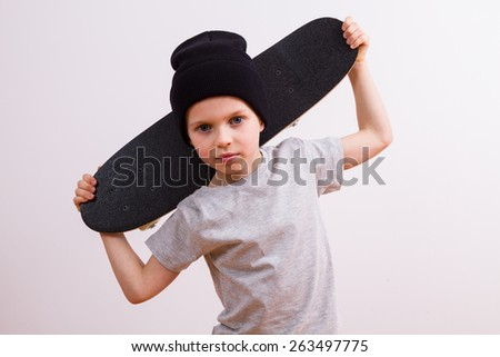 Young boy with skateboard - stock photo