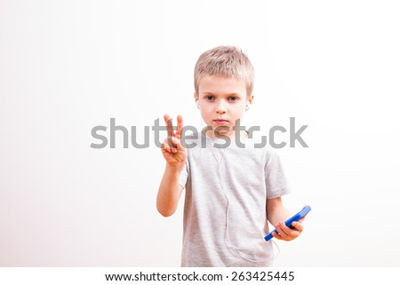 Young boy with smartphone - stock photo