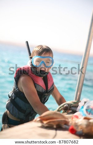 Young boy with snorkel and mask - stock photo