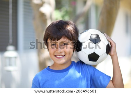 Young boy with soccer ball or football