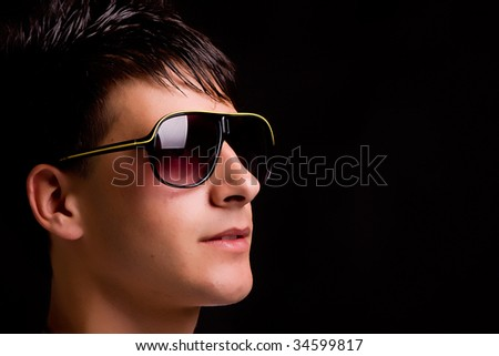 Young boy with sunglasses - low key portrait