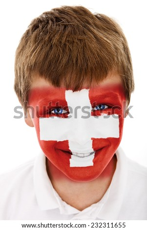 Young boy with Switzerland flag painted on his face - stock photo