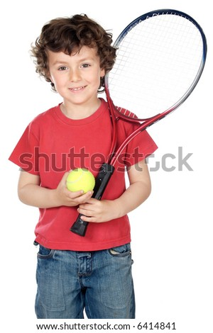 Young boy with tennis racket and ball - stock photo
