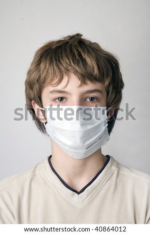 Young boy with the protective mask - stock photo