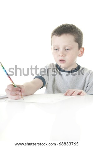 Young boy working on homework - stock photo