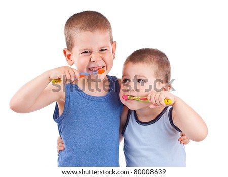 Young boys brushing his teeth with toothbrush, isolated in white - stock photo