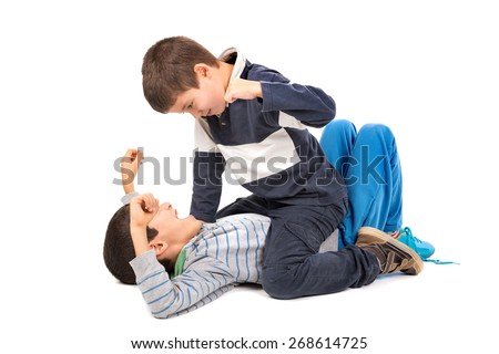 Young boys fighting isolated in white