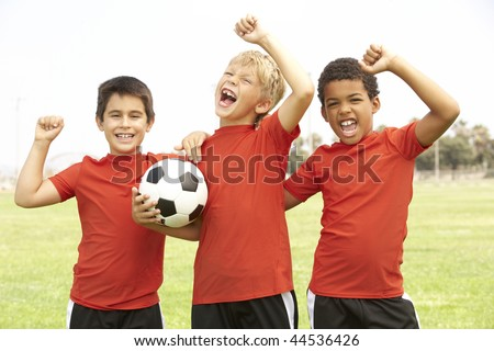 Young Boys In Football Team Celebrating - stock photo