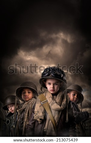 Young boys in soldier uniform in a war zone - stock photo