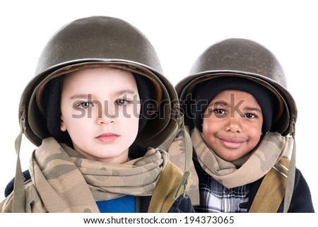 Young boys in soldier uniform isolated in white - stock photo
