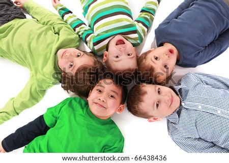 Young boys lying on floor isolated on white background - stock photo
