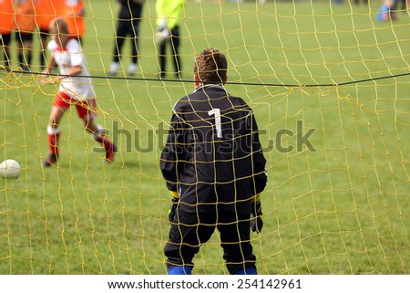 Young boys play football match and doing penalty kick - stock photo