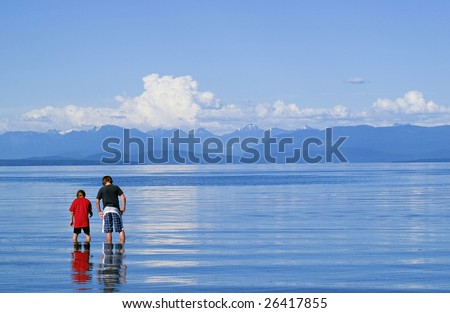 Young boys searching on beach - stock photo