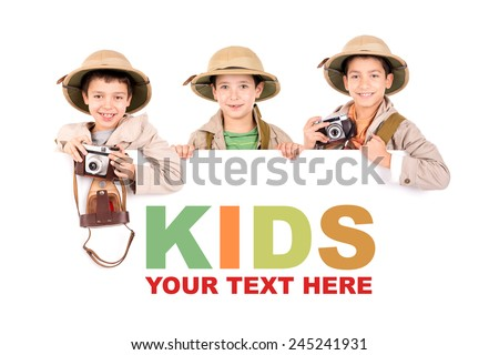 Young boys with camera playing Safari isolated over a white board  - stock photo