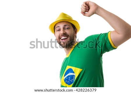 Young Brazilian fan celebrating on white background