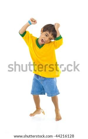 Young Brazilian supporter celebrating a score . - stock photo
