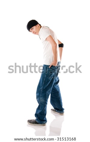 Young breakdancer posing while looking at camera - stock photo