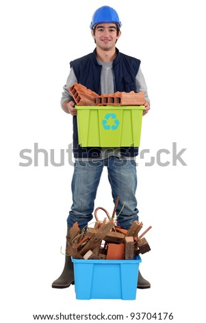 young bricklayer holding recycling tub
