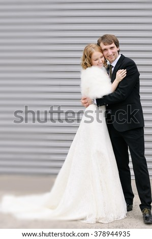 Young bride and groom having fun together