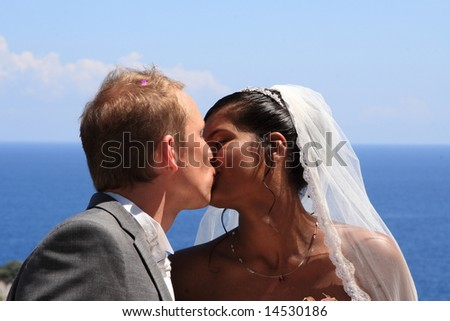 Young bride and groom on the background of the sea