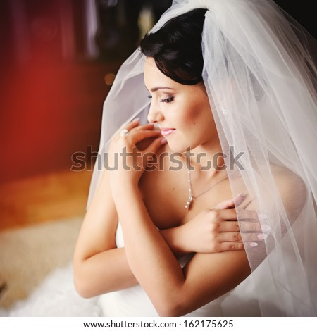 Young bride  at home in the morning. - stock photo
