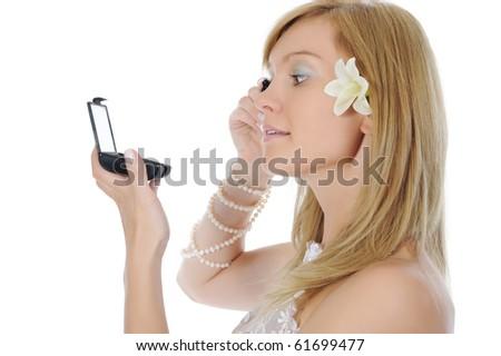 young bride dye eyelashes. Isolated on white background - stock photo