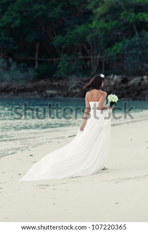 Young bride in a beautiful dress - stock photo