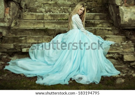 Young bride in a beautiful yard - stock photo