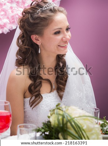 young bride in restaurant sit by banquet table - stock photo