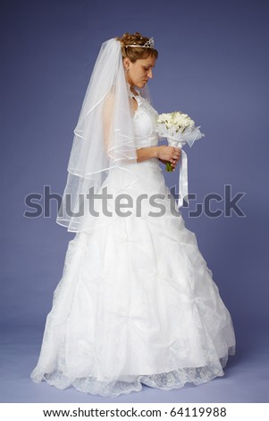 Young bride in white wedding dress with a bouquet - stock photo
