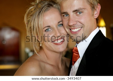 Young bride on her wedding day with her husband - stock photo