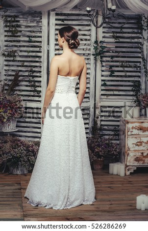 Young bride posing in wedding dress