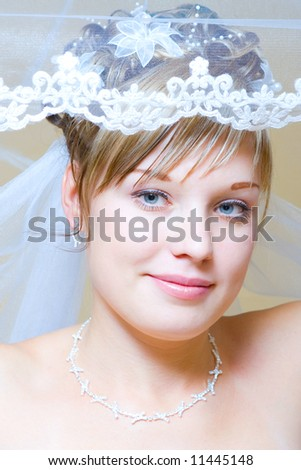 young bride puts on veil on head
