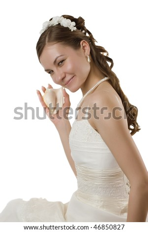 Young bride with a sea shell on white background