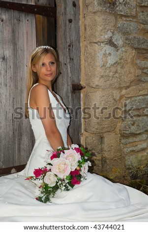 Young bride with blond hair and tiara