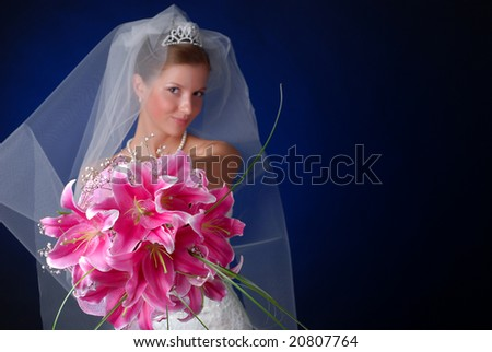 young bride with bouquet of lilys on a black background