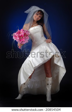 young bride with bouquet of lilys show her legs