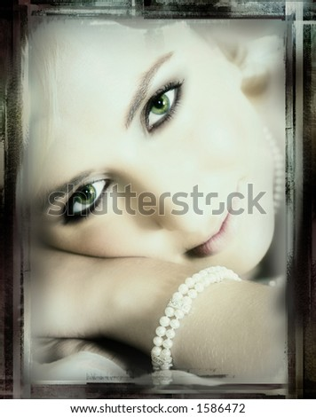 Young bride with large green eyes resting on her hands - stock photo