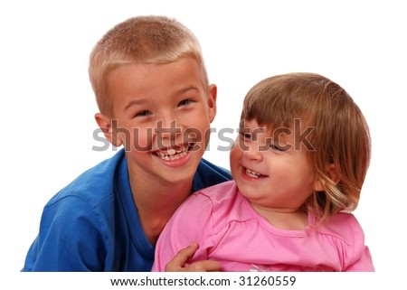 Young brother and sister with happy smiles