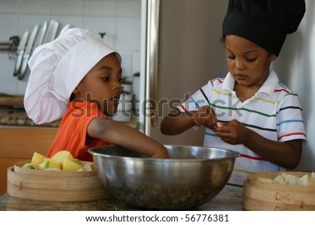 Young brothers preparing a delicious meal. - stock photo