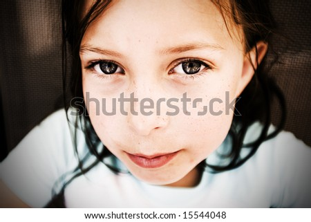 Young Brown Haired Child Looking Directly at the Camera - stock photo