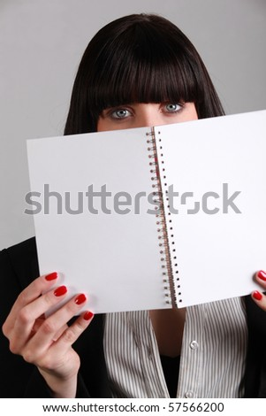 Young brown-haired woman with notebook