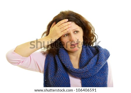Young brown-haired woman with wool scarf has headache, isolated on white background, studio shot.