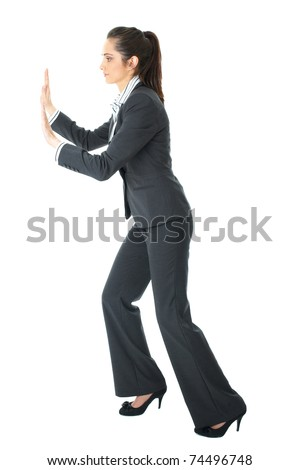 young brunette attractive businesswoman push imaginary wall, isolated on white - stock photo