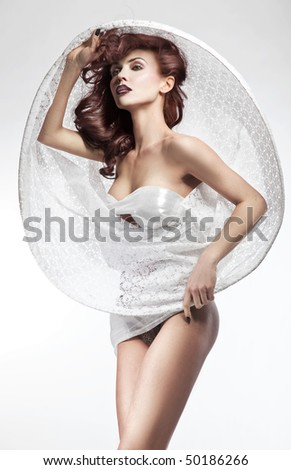Young brunette beauty posing - stock photo
