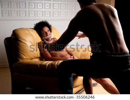 Young brunette being raped and abused with terror expression. - stock photo